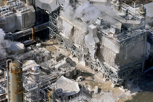 A structure is damaged after an explosion in a processing facility at the ExxonMobil refinery in Torrance, Calif. on Wednesday, Feb. 18, 2015. (AP Photo/Daily Breeze, Brad Graverson)
