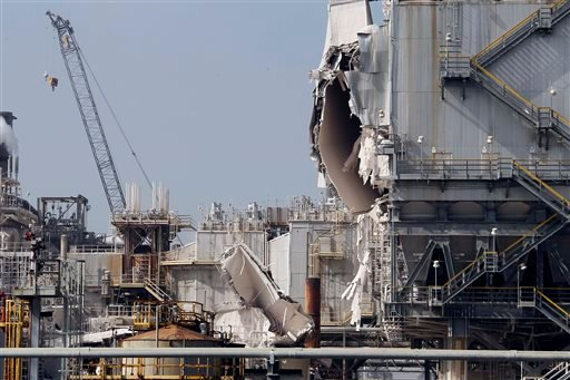 The ExxonMobil refinery is seen after an explosion in a gasoline processing unit at the facility, in Torrance, Calif., on Feb. 18, 2015. Two workers suffered minor injuries and a small fire at the unit was quickly put out. (AP Photo/Nick Ut)