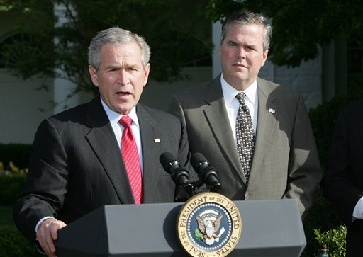 FILE - In this April 19, 2006 file photo, President George W. Bush, accompanied by his brother, then-Fla. Gov. Jeb Bush, speaks on the South Lawn at the White House in Washington. (AP)