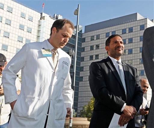 Dr. Zachary Rubin, medical director of clinical epidemiology and infection prevention at the Ronald Reagan UCLA Medical Center, left, and Dr. Robert Cherry, chief medical and quality officer for UCLA Health System, take questions from the media in Los Ang