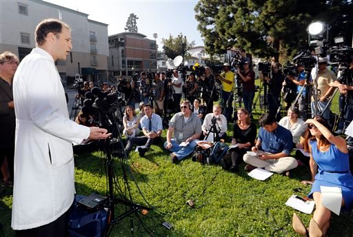 """Dr. Zachary Rubin, medical director of clinical epidemiology and infection prevention at the Ronald Reagan UCLA Medical Center, left, takes questions from the media in Los Angeles Thursday, Feb. 19, 2015. Los Angeles County health officials say a """"superbu"""