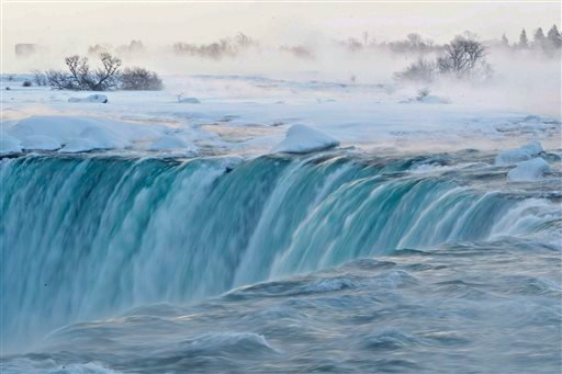 Pieces of ice flow over the Canadian 'Horseshoe' Falls in Niagara Falls, Ontario, Canada, Thursday, Feb. 19, 2015. (AP Photo/The Canadian Press,Aaron Lynett)