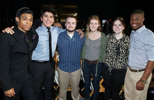 In this Wednesday, Feb. 18, 2015 photo, from left, student trophy presenters Justin Floyd, Chris Carmona, Justin Craig, Kelly FitzGerald, Rhianna Shaheen, and Patrick Walker pose for a photo during rehearsals for the 87th Academy Awards in Los Angeles.