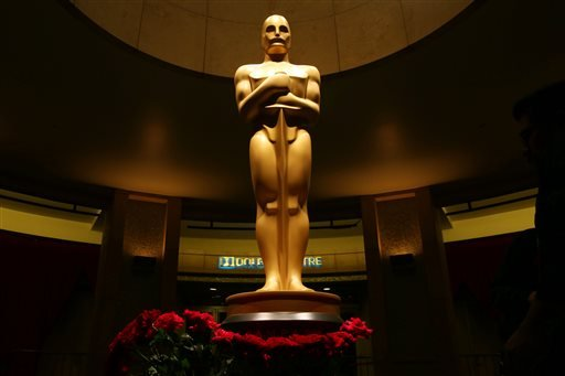 An Oscar statue is seen as preparations are made for the 87th Academy Awards in Los Angeles, Saturday, Feb. 21, 2015. The Academy Awards will be held at the Dolby Theatre on Sunday, Feb. 22. (Photo by Matt Sayles/Invision/AP)