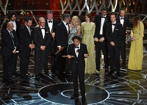 """Alejandro G. Inarritu, center, and the cast and crew of """"Birdman or (The Unexpected Virtue of Ignorance)"""" accept the award for the best picture at the Oscars on Sunday, Feb. 22, 2015, at the Dolby Theatre in Los Angeles. (Photo by John Shearer/Invision/AP"""