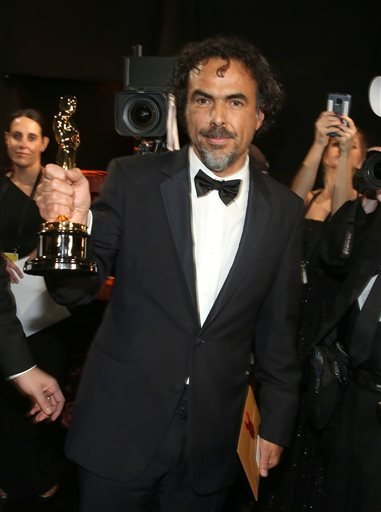 """Alejandro Gonzalez Inarritu appears backstage with his award for best director for """"Birdman"""" at the Oscars on Sunday, Feb. 22, 2015, at the Dolby Theatre in Los Angeles. (Photo by Matt Sayles/Invision/AP)"""