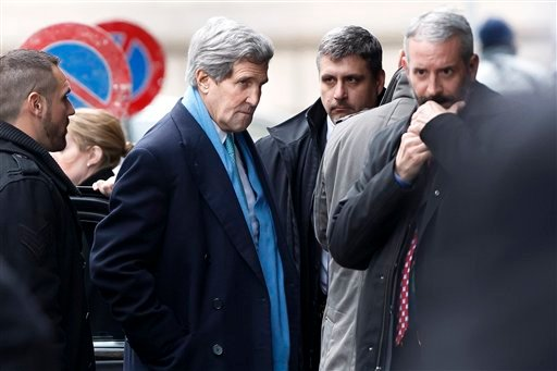 US Secretary of State John Kerry, center, arrives at the hotel prior to a bilateral meeting with Iranian Foreign Minister Mohammad Javad Zarif for a new round of Nuclear Talks, in Geneva, Switzerland, Sunday, Feb. 22, 2015. (AP Photo/Keystone,Salvatore Di