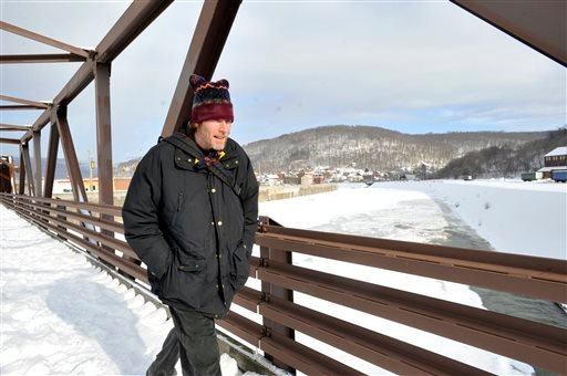 Ron Weaver, of Johnstown, crosses over the frozen Conemaugh River via the old steel workers bridge on yet another frigid morning, Monday, Feb. 23, 2015, in Johnstown, Pa. (AP Photo/The Tribune-Democrat, Todd Berkey) MANDATORY CREDIT