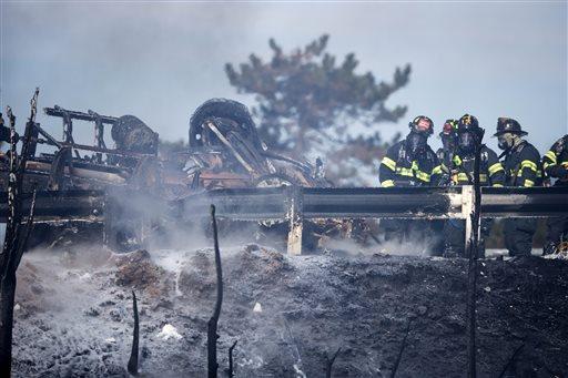 Firefighters work the scene of a tanker truck fire Monday, Feb. 23, 2015, in Pennsauken, N.J. (AP Photo/Matt Rourke)