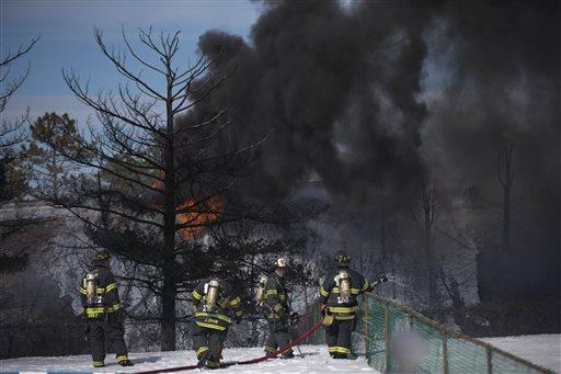 Firefighters view smoke from a tanker truck fire Monday, Feb. 23, 2015, in Pennsauken, N.J. (AP Photo/Matt Rourke)