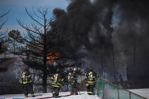 Firefighters view smoke from a tanker truck fire Monday, Feb. 23, 2015, in Pennsauken, N.J. (AP Photo/Matt Rourke)