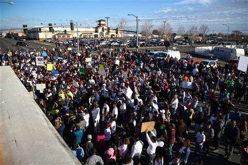 People gather near a memorial during a rally for Antonio Zambrano-Montes, Saturday, Feb. 14, 2015, in Pasco, Wash. Zambrano-Montes was shot and killed by Pasco police in Pasco on Tuesday. (AP)