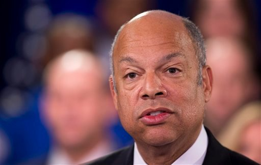 Homeland Security Secretary Jeh Johnson, joined by the department employees, during a news conference in Washington, Monday, Feb. 23, 2015. A partial shutdown of the Homeland Security Department loomed at week's end, but no solution was in sight as senato