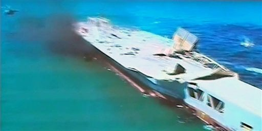 This image taken from Iranian state TV, shows footage of damage to a mock U.S. aircraft carrier during large-scale naval and air defense drills by Iran's Revolutionary Guard, near the Strait of Hormuz, Iran, Wednesday, Feb. 25, 2015.