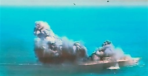 This image taken from Iranian state TV, shows damage to a mock U.S. aircraft carrier during large-scale naval and air defense drills by Iran's Revolutionary Guard, near the Strait of Hormuz, Iran, Wednesday, Feb. 25, 2015.