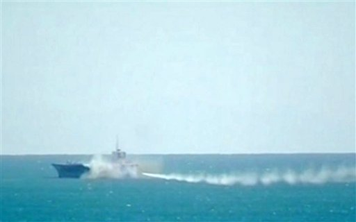 This image taken from Iranian state television shows footage of a missile fired at a mock U.S. aircraft carrier during large-scale naval and air defense drills by Iran's Revolutionary Guard, near the Strait of Hormuz, Wednesday, Feb. 25, 2015.