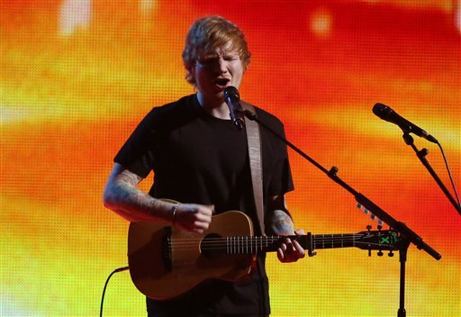 Ed Sheeran performs onstage at the Brit Awards 2015 at the 02 Arena in London, Wednesday, Feb. 25, 2015. (Photo by Joel Ryan/Invision/AP)