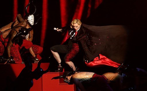 Madonna stumbles whilst performing on stage during the Brit Awards 2015 at the 02 Arena in London, Wednesday, Feb. 25, 2015. (AP Photo/PA, Yui Mok)