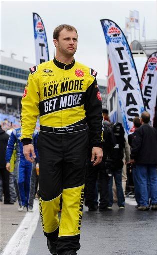 In this April 6, 2014, file photo, Travis Kvapil walks the track before a rain delayed start for the NASCAR Sprint Cup Series auto race at Texas Motor Speedway in Fort Worth, Texas.