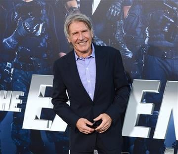 """FILE - In this Aug. 11, 2014 file photo, Harrison Ford arrives at the premiere of """"The Expendables 3"""" at TCL Chinese Theatre in Los Angeles."""