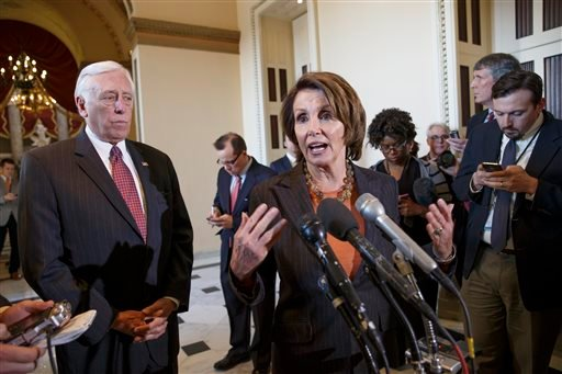 House Minority Leader Nancy Pelosi of Calif., accompanied by House Minority Whip Steny Hoyer of Md., gestures during a news conference on Capitol Hill in Washington Feb. 27, 2015. (AP Photo/J. Scott Applewhite)