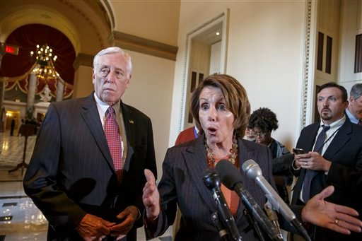 In this Feb. 27, 2015, photo, House Democratic Leader Nancy Pelosi of Calif., accompanied by House Minority Whip Steny Hoyer of Md., voice their objections to the Republican majority during a delay in voting for a short-term spending bill for the Homeland