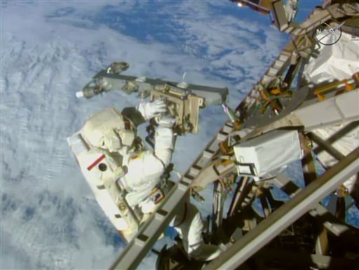 In this image from NASA television astronaut Terry Virts installs an antenna and boom during the third spacewalk outside the International Space Station Sunday March 1, 2015. American astronauts Terry Virts and Butch Wilmore had 400 more feet of power and