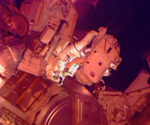 """In this image from NASA television astronaut Barry """"Butch"""" Wilmore, right, and Terry Virts are seen during their third spacewalk outside the International Space Station Sunday March 1, 2015. (AP Photo/NASA-TV)"""