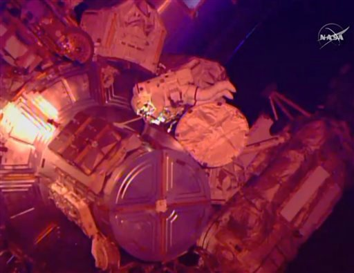 In this image from NASA television astronaut Terry Virts exits the Quest airlock hatch beginning the third spacewalk outside the International Space Station early Sunday morning March 1, 2015. Terry Virts and Butch Wilmore have 400 feet of cable and two a