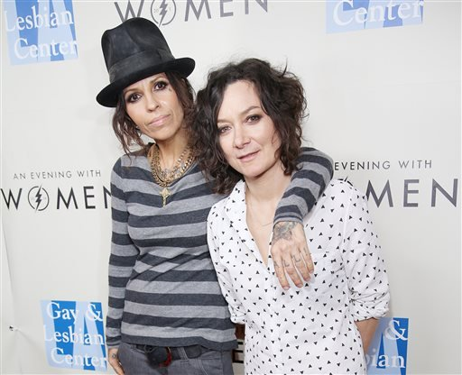 """FILE - In this March 15, 2014 file photo, Linda Perry, left, and Sara Gilbert arrive at L.A. Gay and Lesbian Center """"An Evening with Women"""" Kick Off Concert Event in West Hollywood, Calif. (AP)"""