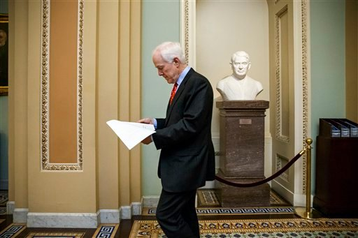 Senate Majority Whip John Cornyn, R-Texas, heads to the chamber for a procedural vote on a funding bill for the Department of Homeland Security that has produced partisan gridlock in the first several weeks of the new Congress, at the Capitol in Washingto