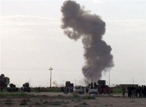 In this image made from video, smoke rises from an explosion as Iraqi forces, Shiite militiamen and Sunni tribal fighters battle Islamic State militants for control of Tikrit, Iraq, Tuesday, March 3, 2015. Backed by Shiite militias and Sunni tribal fighte