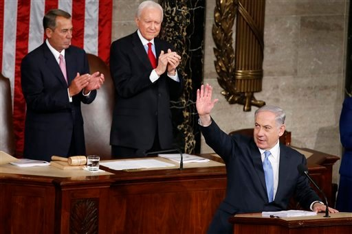 Israeli Prime Minister Benjamin Netanyahu waves as he step to the podium prior to speaking before a joint meeting of Congress on Capitol Hill in Washington, Tuesday, March 3, 2015. Prime Minister Netanyahu is using the address to warn against trusting Ira