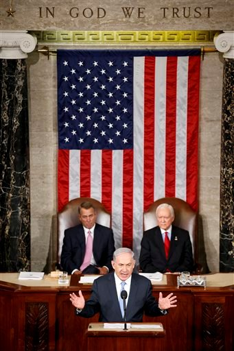Israeli Prime Minister Benjamin Netanyahu speaks before a joint meeting of Congress on Capitol Hill in Washington, Tuesday, March 3, 2015. Netanyahu is using the address to warn against trusting Iran to curb its nuclear ambitions. House Speaker John Boehn