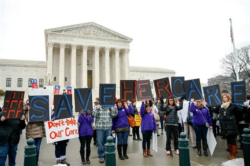 Members of the National Family Planning and Reproductive Health Association rally outside the Supreme Court in Washington, Wednesday, March 4, 2015. (AP Photo/Andrew Harnik)