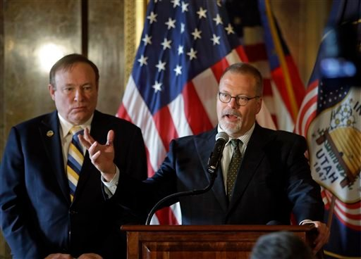 In this Jan. 27, 2015, photo, Sen. Stephen Urquhart, R-St. George, right, speaks to reporters while Sen. Jim Dabakis, D-Salt Lake City, left, listens during a news conference at the Utah State Capitol, in Salt Lake City. (AP)