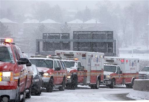 Emergency vehicles line up outside of a terminal at LaGuardia Airport in New York, Thursday, March 5, 2015. A plane from Atlanta skidded off a runway at the airport while landing Thursday, crashing through a chain-link fence. (AP Photo/Seth Wenig)