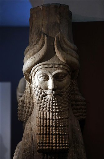 "This Monday, Sept. 15, 2014 file photo shows a detail of a statue from the Assyrian period displayed at the Iraqi National Museum in Baghdad. Islamic State militants ""bulldozed"" the renowned archaeological site of the ancient city of Nimrud in northern Ir"
