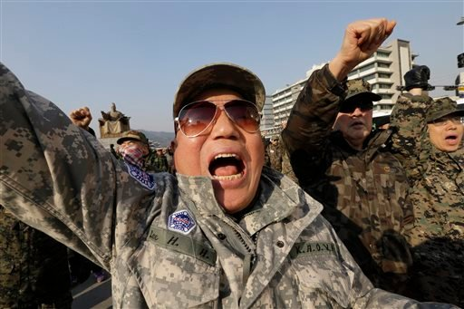 South Korean Vietnam War veterans shout slogans during a rally denouncing the attack on U.S. Ambassador to South Korea Mark Lippert near the U.S. embassy in Seoul, South Korea, Friday, March 6, 2015. (AP)