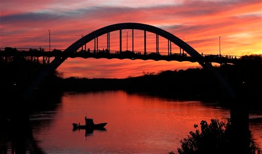 The sun sets over the Edmund Pettus Bridge where preparations for the 50th anniversary of the civil rights march with a visit Saturday with President Barack Obama and the first family, Friday, March. 6, 2015, in Selma, Ala. This weekend marks the 50th ann