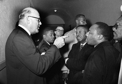 In this March 1, 1965 file photo, Registrar Carl Golson shakes a finger at Dr. Martin Luther King Jr., during meeting at the courthouse in Hayneyville, Ala. King inquired about voter registration procedures but Golson told him that if he was not a prospec