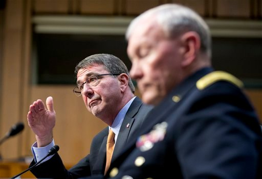 In this March 3, 2015 file photo, Defense Secretary Ash Carter, left, accompanied by Joint Chiefs Chairman Gen. Martin Dempsey, testifies on Capitol Hill in Washington before the Senate Armed Services Committee. Iran's growing influence in Iraq is setting