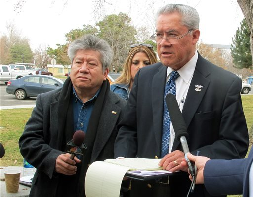 In this Feb. 25, 2015 file photo, activist Felix Vargas, right, talks with reporters in Kennewick, Wash., after a briefing on the investigation of the fatal police shooting of Antonio Zambrano-Montes, who was unarmed, in nearby Pasco, Wash., on Feb. 10. V