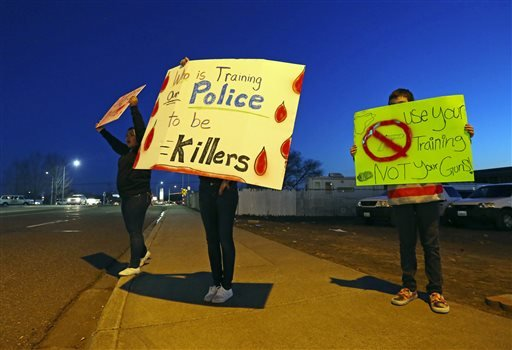 In this Feb. 12, 2015 file photo, demonstrators gather at the corner where the shooting of Antonio Zambrano-Montes took place in Pasco, Wash. Ferguson, Mo., has become an emblem of the tensions between minorities and police departments nationwide since Da