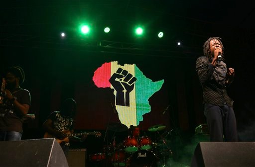 "In this Feb. 18, 2015 photo, Jamaican singer Melbourne Douglas known as known as dBURNZ, entertains the crowd at a show organized by the Jamaica Reggae Industry Association during the island's ""reggae month,"" in Kingston, Jamaica. Around the world, music"
