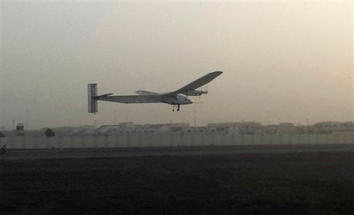 A Swiss solar-powered plane takes off at an airport in Abu Dhabi, United Arab Emirates, early Monday, March 9, 2015, marking the start of the first attempt to fly around the world without a drop of fuel. Solar Impulse founder Andre Borschberg was at the c