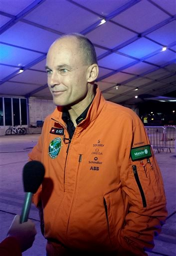 Solar Impulse co-founder Bertrand Piccard speaks to reporters at an airport in Abu Dhabi, United Arab Emirates before scheduled takeoff Monday, March 9, 2015. Piccard is one of two Swiss pilots who will be flying the aircraft in its first round-the-world