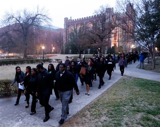 Students at the University of Oklahoma protest a fraternity's racist comments on Monday, March 9, 2015 in Norman, Okla.