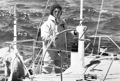 In this May 26, 1979 file photo, Florence Arthaud of France steers her 15 meter monohull called Biotherm off the Brittany coast. Two helicopters carrying French sports stars filming a popular European reality show crashed Monday March 9, 2015 in a remote