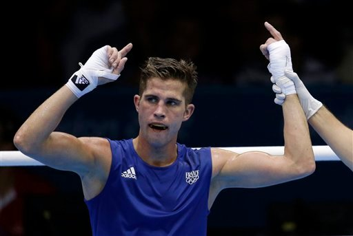 In this Aug. 3, 2012 file photo, France's Alexis Vastine reacts after defeating Mongolia's Tuvshinbat Byamba in a men's welterweight 69-kg preliminary boxing match at the 2012 Summer Olympics, in London. Two helicopters carrying French sports stars filmi